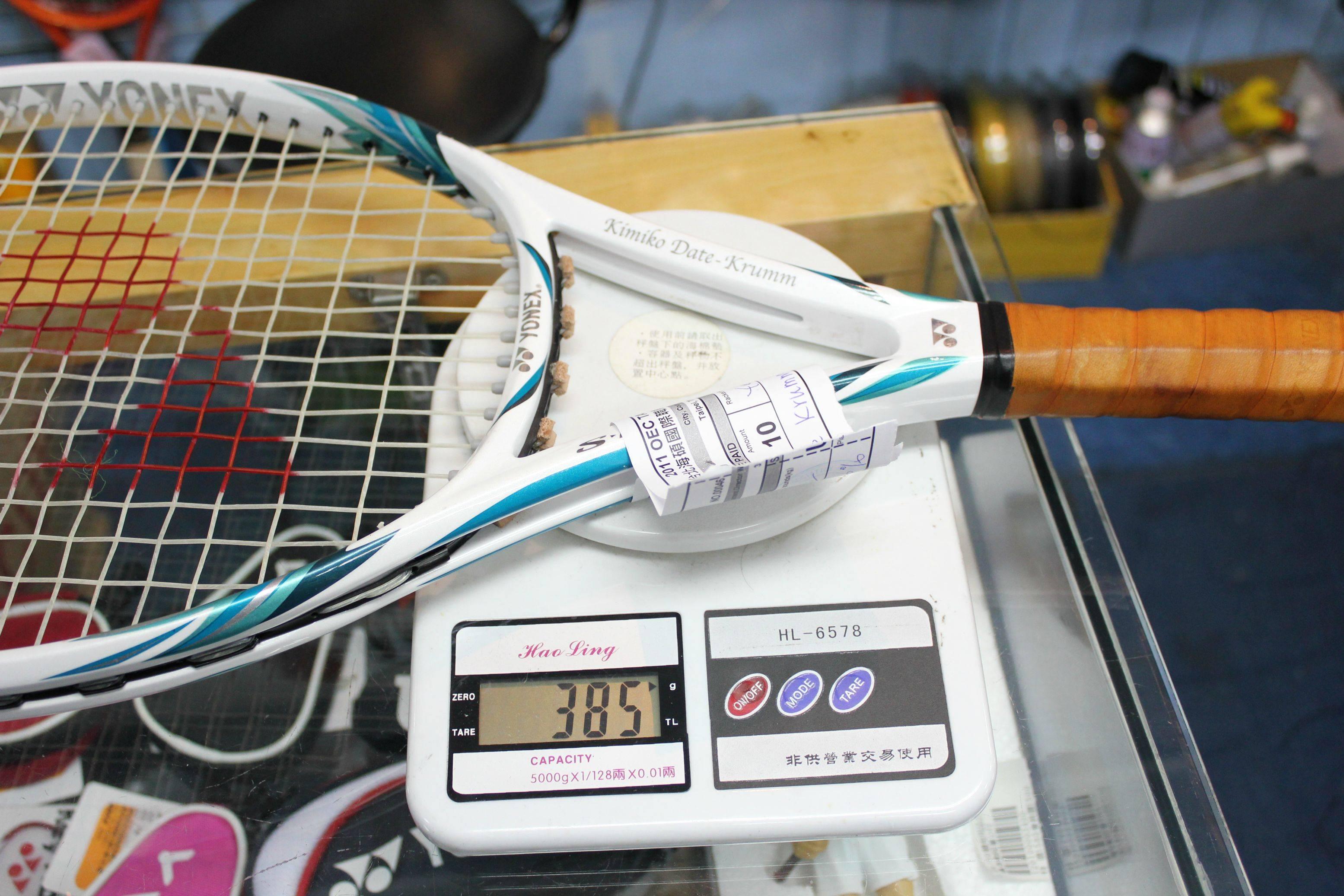 вес теннисной ракетки